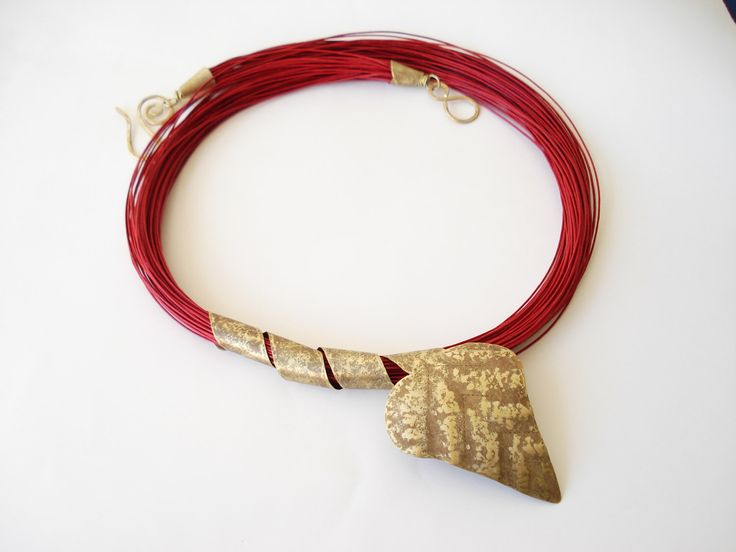 Unique Handmade Statement necklace-Hand Hammered Gold Bronze Leaf-Wax Linen Cord-Contemporary necklace-Handcrafted Jewelry-Unusual necklace by AnnaRecycle on Etsy https://www.etsy.com/listing/205407482/unique-handmade-statement-necklace-hand