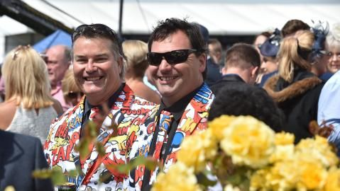 Patrons brought plenty of colour to the track. Picture: AFP