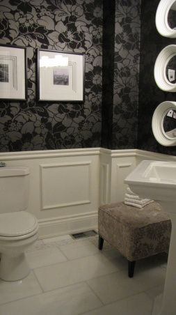 Black and white bathroom. luv the picture frame molding and the flocked wallpaper!