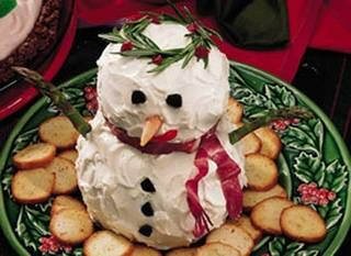 Deck your snowman cheese ball out in holiday edible gear.