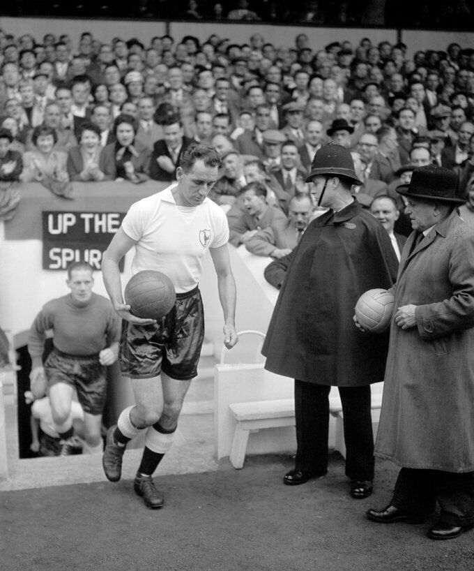 Tottenham's Harry Clarke runs up the steps and out onto the White Hart Lane pitch, 1956.