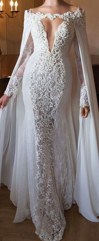 Lace wedding dress with cape by Berta Bridal