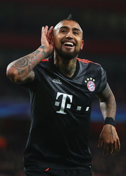 Arturo Vidal of Bayern Muenchen celebrates as he scores their fourth goal during the UEFA Champions League Round of 16 second leg match between Arsenal FC and FC Bayern Muenchen at Emirates Stadium on March 7, 2017 in London, United Kingdom.