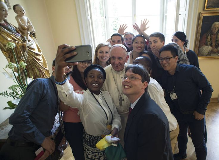 Pope francis poses for a selfie with youths after he had lunch with them at the bishop's residence in krakow, poland, saturday, july 30, 2016. the religious