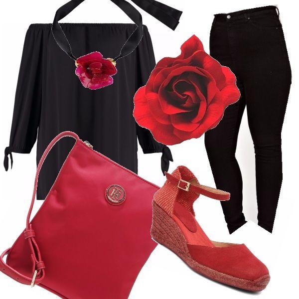 Per la donna curvy un outfit pratico e decisamente comodo che non rinuncia alla femminilità: il pantalone aderente nero si abbina alla blusa che lascia scoperte le spalle. Gli accessori giocano con i toni del rosso: la borsa a tracolla, la scarpa con la zeppa, la collana in raso e il fermacapelli come una danzatrice di flamenco.