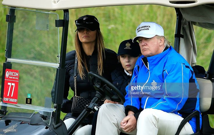 Donald Trump watches the action with wife Melania and son Barron during the Third Round of the Ricoh Women's British Open at Turnberry Golf Club on August 1, 2015 in Turnberry, Scotland.