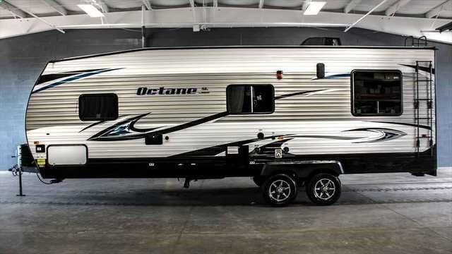 2016 New Jayco Octane ZX Super Lite 273 Toy Hauler in Michigan MI.Recreational Vehicle, rv, 2016 Jayco Octane ZX Super Lite 273, Octane ZX Super Lite 273 Toy Hauler Travel Trailer Rear Garage Escape for a fun time with the 2016 Octane ZX Super Lite 273 toy hauler. Light on weight but heavy on amenities, this trailer guarantees a great adventure! Jayco Octane ZX Super Lite 273 Layout The layout of the Octane ZX Super Lite 273 features a front bedroom/bathroom combo, a central kitchen, a...