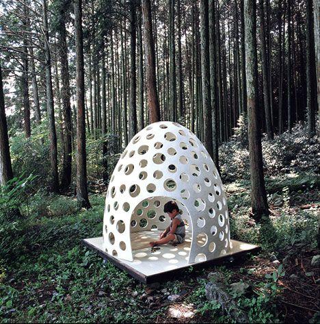 Kazuya Morita's concrete pod via Yanko Design: that's some cubby house. Great idea to incorporate cut outs.