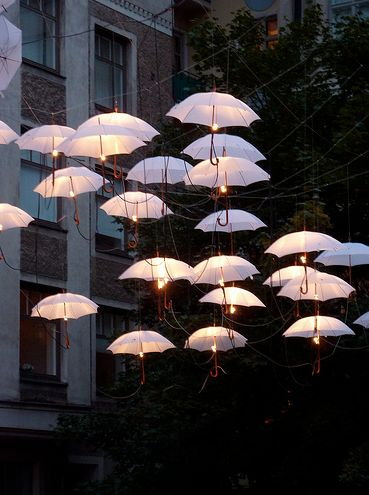 Umbrella Outdoor lights-what a cute idea for a whimsical bedroom. Change it up…