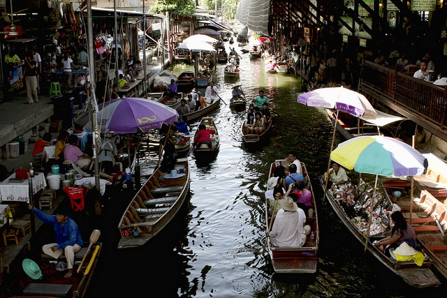 Damnoen Saduak, Floating Market, Thailand - by Diego Rios    One of the most famous of the floating markets in Thailand is Damnoen Saduak, about 100 kilometers southwest of Bangkok.    This buzzing market is at its best in the early morning before the crowds arrive and the heat of the day builds up.    Very colorful and vibrant atmosphere in this wonderful place in Thailand.