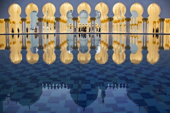 A reflection of the Sheikh Zayed Grand Mosque in the basin of the fountain opposite the mosque where the main dome of the mosque appears. Photo and caption by Dhafer Al shehri