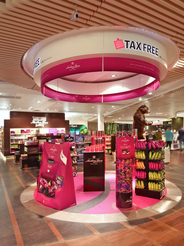 The new Tax-Free Shop is also characterized by its so called stages. The stages have themes that are changing every month. In this picture the stage has been taken over by Anthon Berg - a famous Danish chocolate brand. Mmmm... :-)