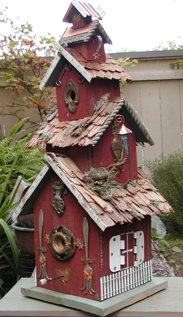 Birdhouse made of  recycled barn wood, copper plumbing, bark, & hardware.                                                                                                                                                      More