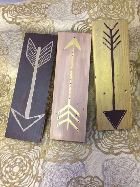 Set of 3 wooden pieces with painted arrows. Shimmery gold, tan and dark maroon. Sprayed with protective finish. No hardware fixtures attached.