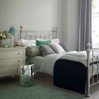 Pale grey bedroom with nickel bed