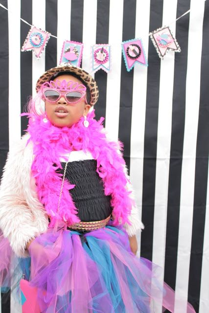 Birthday girl having tons of fun at a dress up for her fashionista party