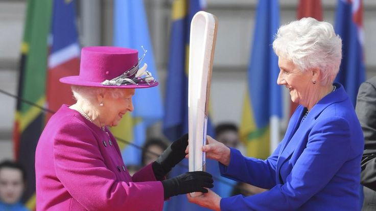 The Queen handed the baton to athletes at Buckingham Palace to coincide with Commonwealth Day.