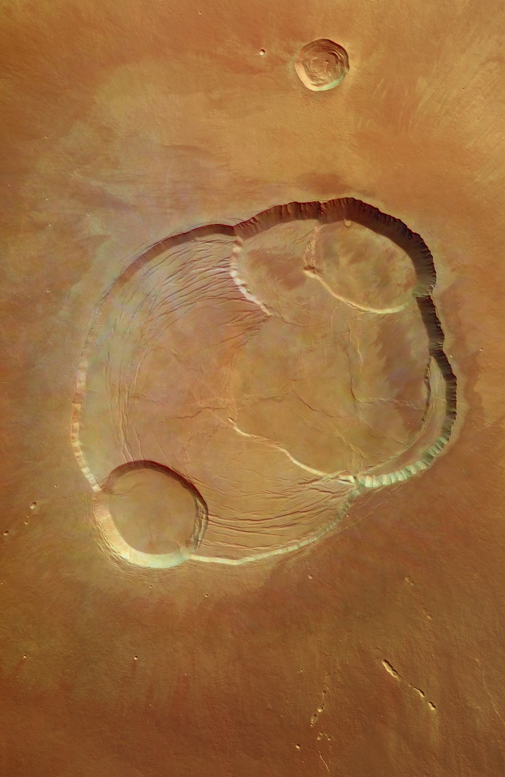 Overhead view of the complex caldera at the summit of Olympus Mons on Mars, the highest volcano in our solar system.