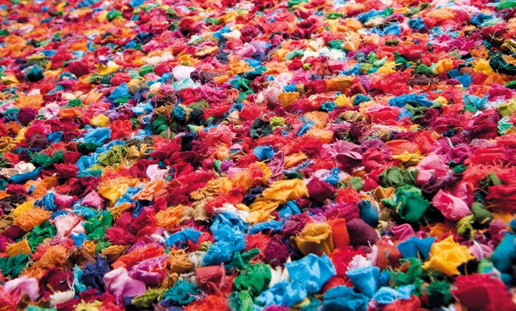 Popcorn RPPOPC-9999  Popcorn is a carpet full of colour, both ecological and playful. 100% composed of fabric from old T-shirts. Worn down to the threads? Grown tired of the look? Or did you outgrow it? Don´t throw it away. Give it here. It´s back in fashion. It´s even lying at your feet.