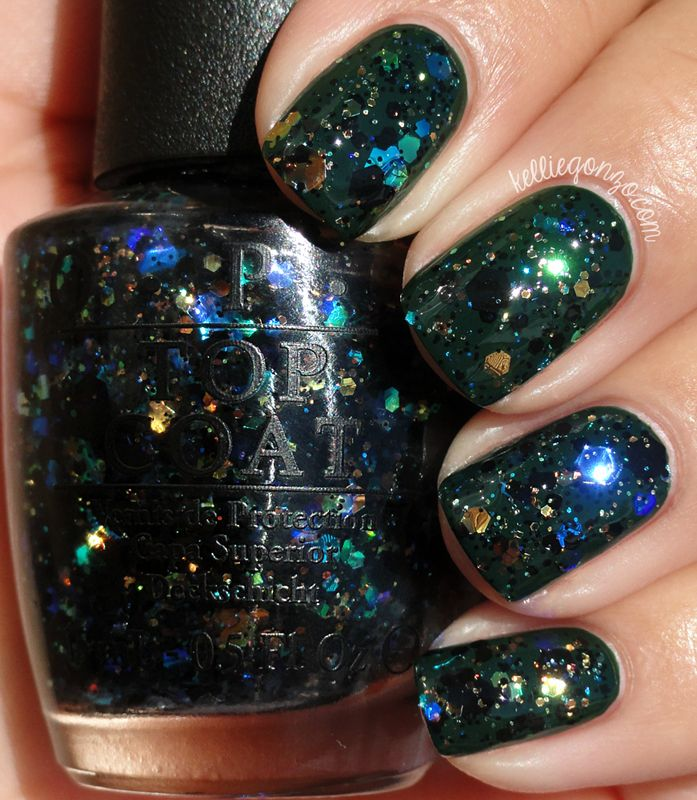 Even more unexpected is OPI Comet In the Sky.This is a multi-sized mix of black and iridescent rainbowy flake hex glitters in a clear base. All I can say is WOW and you have to see how awesome this is in person! I wore two coats over OPI Christmas Gone Plaid. You may have to place some of the larger glitter but it's worth it! I've included a shade photo to show it looks amazing in both bright and lower lights.
