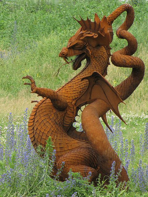Dragon, metal art, found on a back road country drive somewhere between Sutton and Beaverton, Ontario, Canada. By Canadian sculptor Ken Nice.