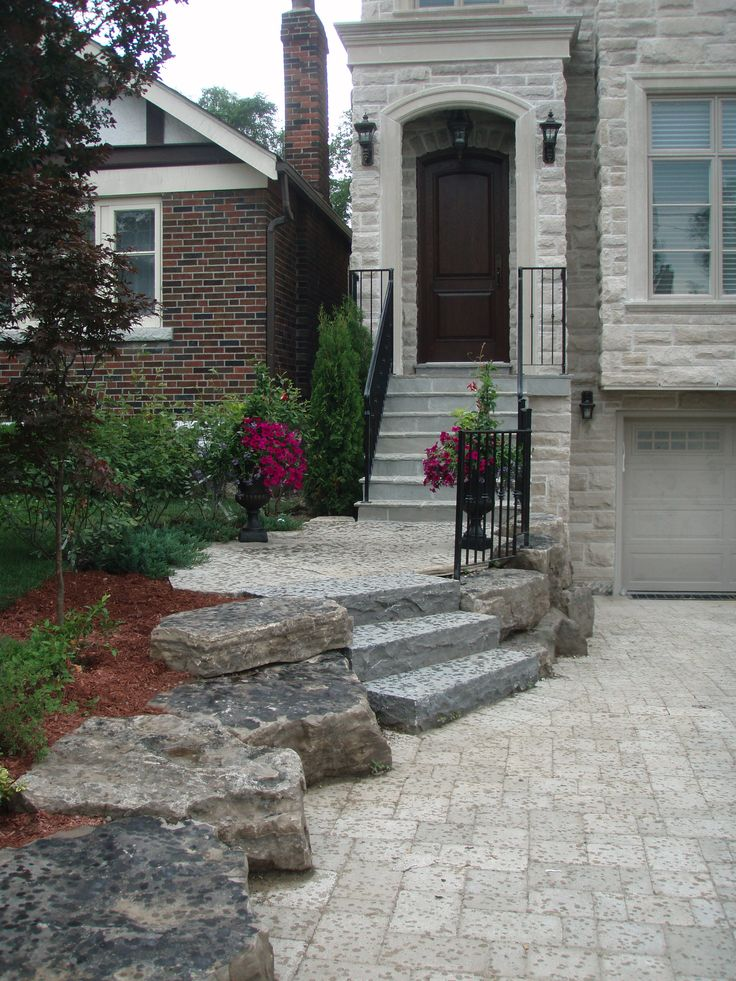 Interlocking tumbled stone driveway and flagstone steps drive lined with armour stone Home driveway design ideas