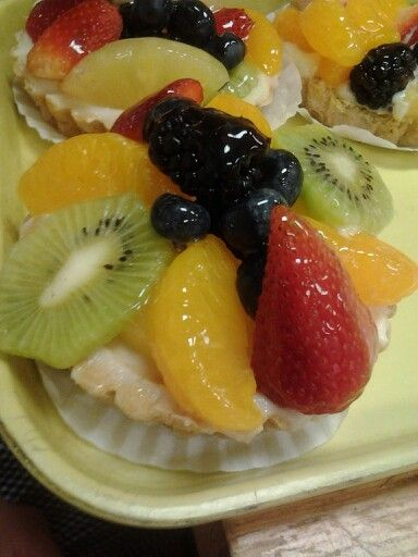 Furit tart puff pastry crust frosted with cheese filling topped with fresh fruit and almond glaze