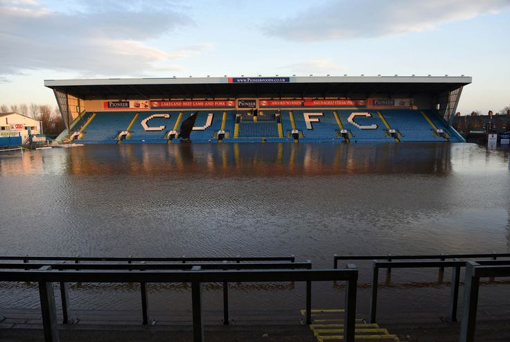 Floodwater covers the pitch and some of the stands at Carlisle United Football Club's Brunton Park stadium in Carlisle, England, on December 7, 2015, after heavy flooding caused by Storm Desmond. The storm left tens of thousands without power, disrupted water supplies, and forced the closure of a number of schools.