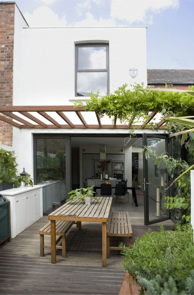 Continuing to the outside.  Pergola / dining table arrangement via Living etc