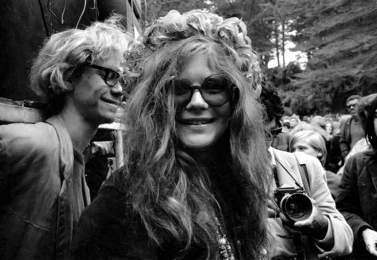 Janis Joplin smiles for the camera at an outdoor festival, circa 1970. Phil Ochs