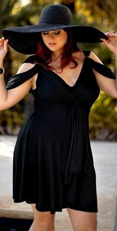 I thought it was a dress....swimsuit....so my style .....love it and the hat....have one similar.