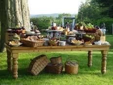 Rustic outdoor buffet display.