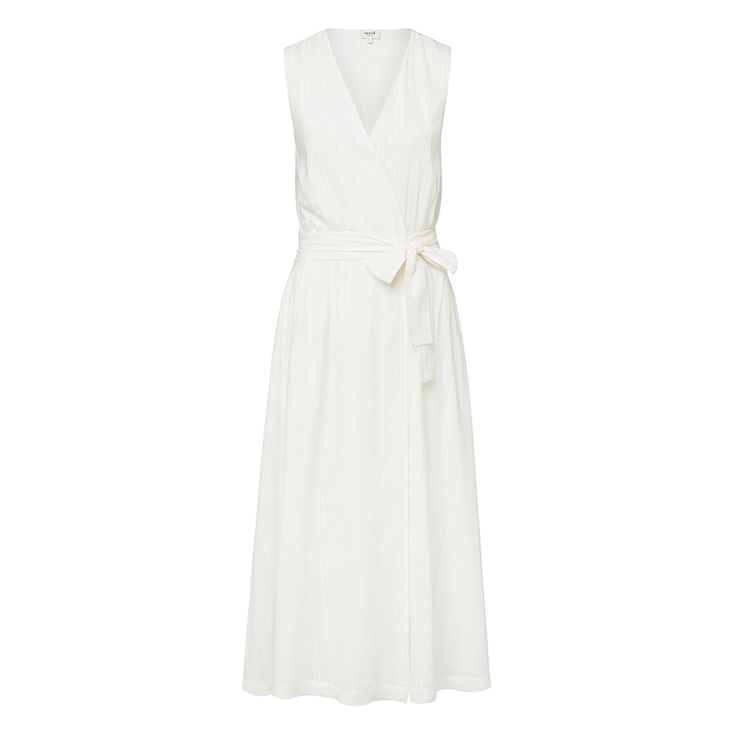 100% Cotton Wrap Cheesecloth Dress. Comfortable yet neat fitting sleeveless style features a low wrap front body with waist tie and full maxi skirt in an all over textured woven fabrication. Available in Cream as shown.