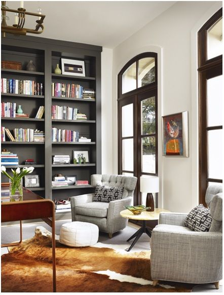 love the floor to ceiling windows, the white, the dark contrasting bookshelf.