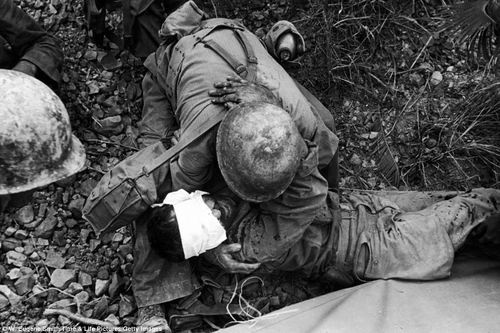 On the Marianas Islands, an American soldier comforts a wounded comrade during the fight. More than 3,000 U.S. troops perished in the battle.: Troops Perish, Pacific War, Wounded Comrad, War Ii, Soldiers Comforter, Army United, Eugene Smith, Marianas Islands Saipan, American Soldiers