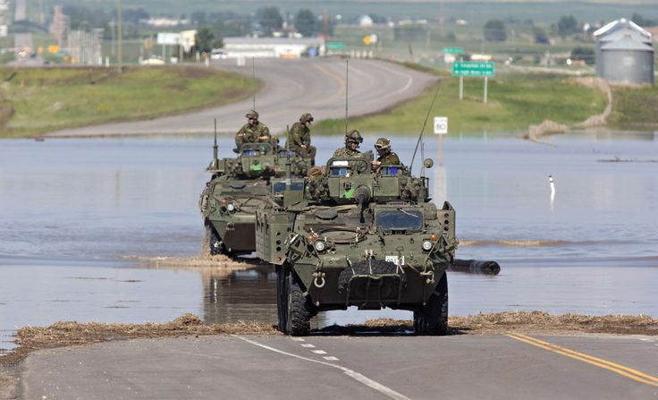 High River Flooding: Canadian Army Descends On War Zone-Like Flooded Town
