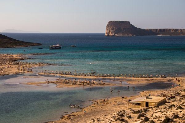 Umbrellas line in Balos Lagoon, western Crete