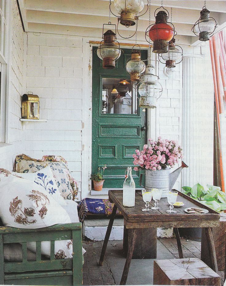 The perfect porch! I would even consider sitting outside if I had a space like this!