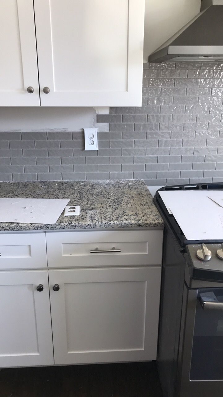 Santa Cecilia Light Granite Taupe Glass Backsplash White