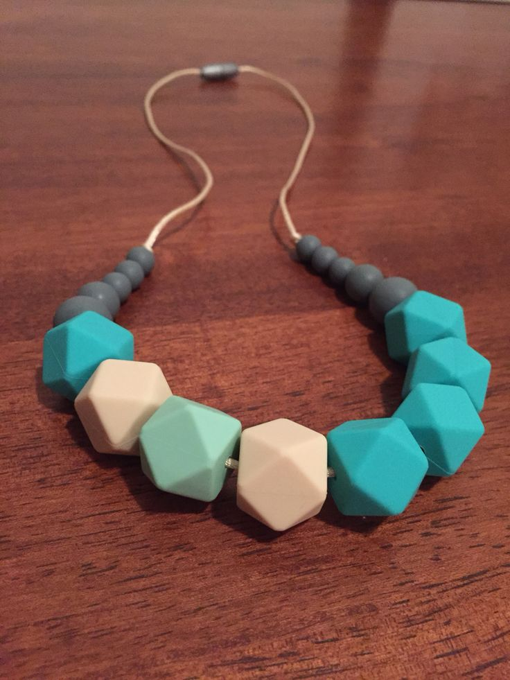 Silicone Teething Necklace - Fussy Little Fox Hexagon Teething Necklace in turquoise, vanilla, mint and grey on vanilla nylon cord with silver safety catch. $27 + Free Shipping within Australia. Visit Fussy Little Fox on Facebook or email fussylittlefox@gmail.com to order #fussylittlefox #bpafree #fdaapproved #nontoxic #siliconeteethingnecklace #teething #soregums #baby #dribble #mum #fashion #necklace #chew #oralsensory #sensorychew #fussy #fussybaby #handmade #handmadewithlove