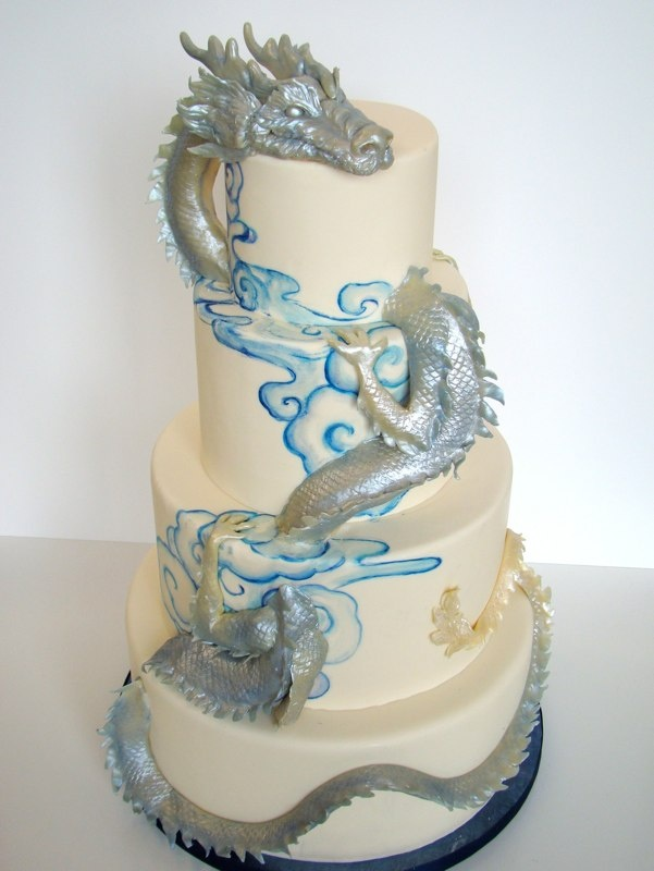 A hand sculpted dragon weaving in and out of the cake by The Butter End.