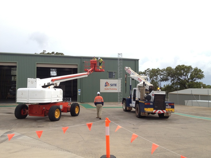 A photo from the Intermediate #Rigging course at our #Gladstone facility. The riggers are using a Genie #Skyreach S85 Elevated Work Platform (EWP) to guide the the #Terex AT15 Franna #Crane