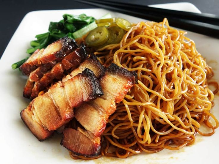 Delicious Dry Wonton Noodles, flavored with garlic & shallot oil. Served with smoky Chinese BBQ Pork & sour and spicy pickled green chilies.