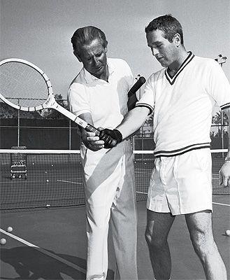 Paul Newman gets a lesson at The Racquet Club.