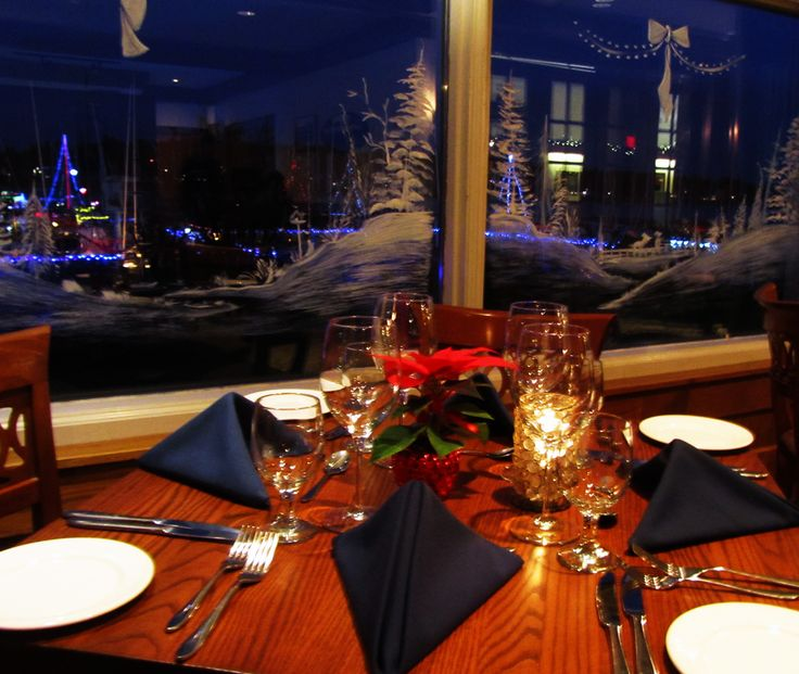 RVYC Dining Room at Christmas Time with boats lit up for the Sea of Lights - Lighted Ship Parade