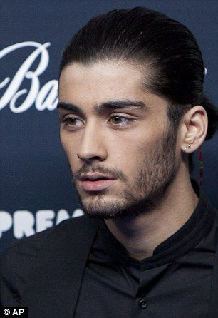 Looking sharp: Zayn Malik wore his hair back in a ponytail while Niall Horan wore his lock...