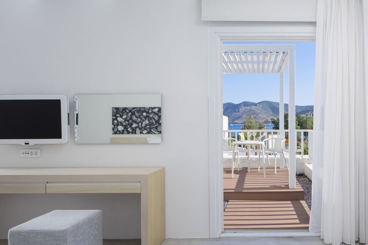 The sea in these suites is visible from every corner, even from your sumptuous double bed. #Patmos