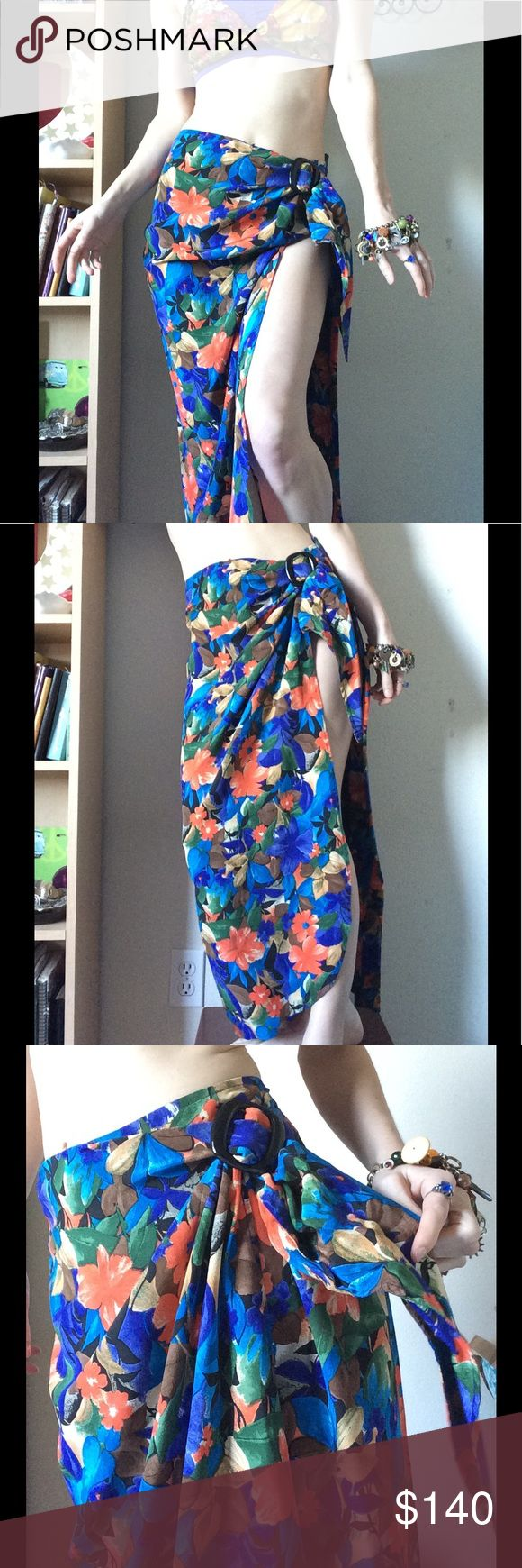 PURE SILK Tropical Hawaiian Hibiscus Sarong Skirt Stunning old school 50's beach vibe. Vintage express label. Probably 80's. Smoke free home. Excellent, new condition. Overlapping style. You can Button it and wrap around so your legs don't show or Button behind for a slinky bare leg look. Hawaii or Bahamas vacation here we come! Perfect for a swim suit cover up on a cruise. Shawl style. Multi colors like bird of paradise orange and ocean indigo Blue. Size 7. Sarong. Maxi skirt. Tie on hip…