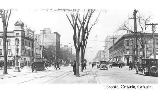 CCT0007 - Looking north on Spadina Ave. toward Queen Street West. Mary Pickford Theatre in NW corner, CIBC on NE. Toronto, Ontario c1924.
