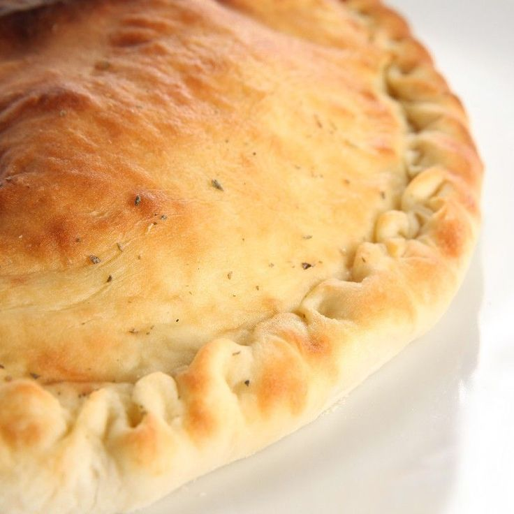 Real Italian Calzones: homemade dough filled with ricotta, Cheddar cheese, pepperoni & mushrooms. #recipe